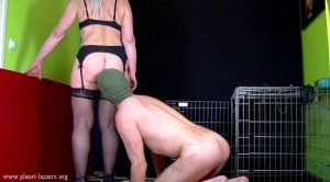 Madame Jeanette in Shit-eater from cage (Femdom Scat Video)