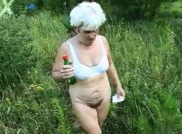 Granny shitting outdoor - 1