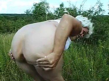 Granny shitting outdoor - 5